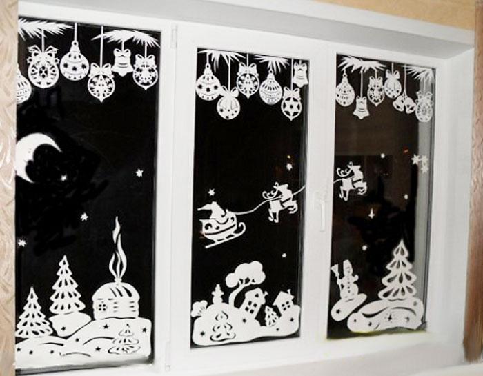 Как украсить окно на Новый год вытынанками